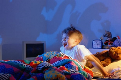 Boy-5-7-screaming-at-shadows-of-monsters-on-wall